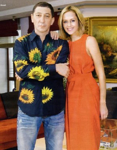 Grigory Leps with his wife Anna in a photo shoot for