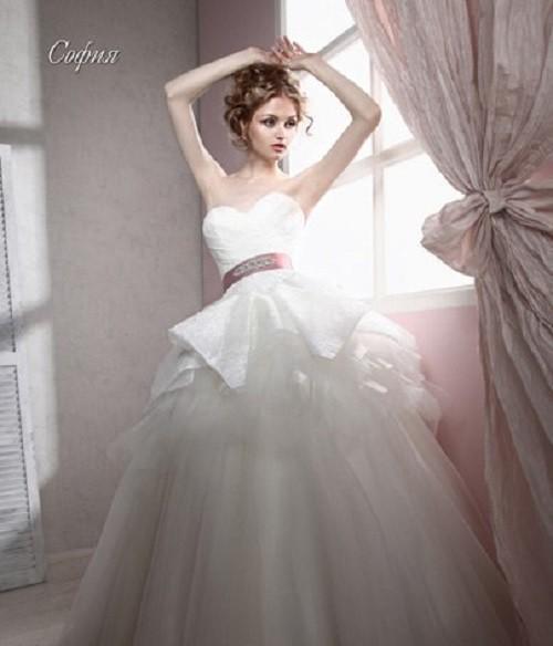 In a white dress.