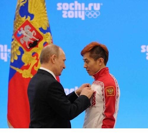 Vladimir Putin awarding Viktor Ahn 24 February 2014 Sochi