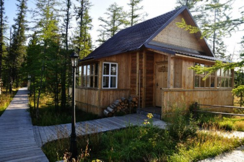 Far away, on the Olenek River, there is a very comfortable camp site with TVs, a bathhouse, cozy cottages ...