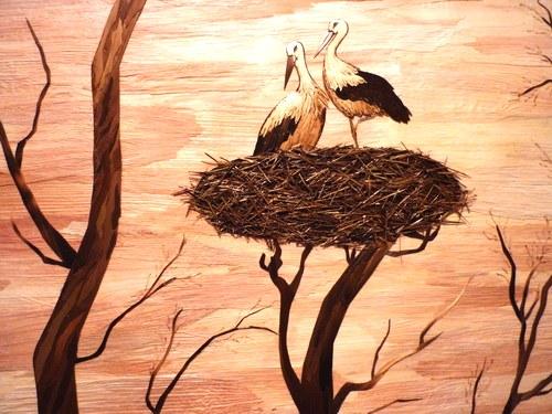 Painting of Storks. Straw art by Lydiya Retivskaya