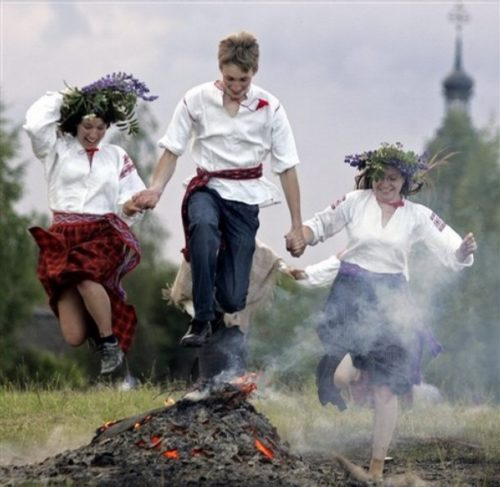 Russian custom to jump over the fire on the night of Ivan Kupala