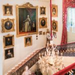 The stairs at the entrance to the hall of the museum Hillwood shows portraits of the royal Romanov family