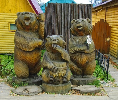 Wood sculptures of bears