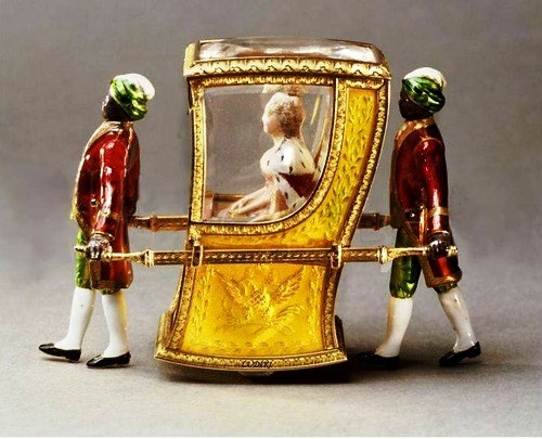 In a letter to her sister Alexandra, Maria Feodorovna notes that the surprise in this egg was a mechanical palanquin with Catherine the Great inside, carried by two araps.