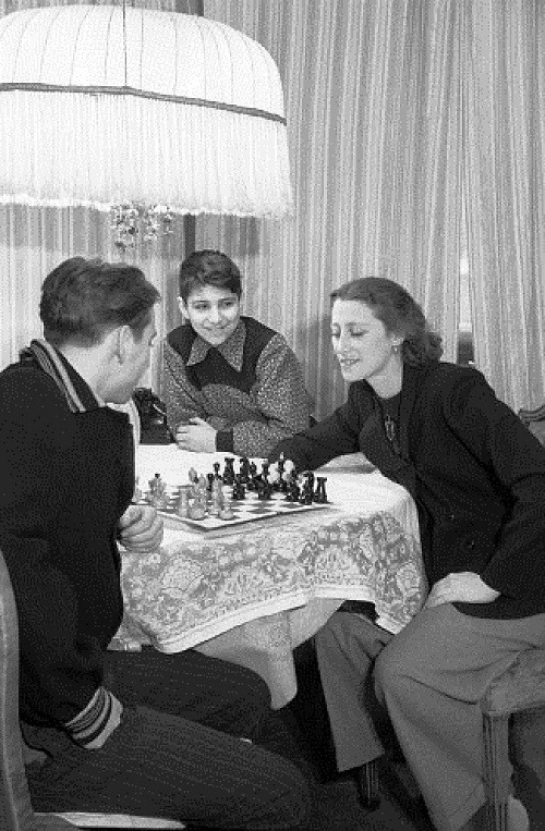 Maya Plisetskaya with her brothers Alexander (left) and Boris during a game of chess, 1950