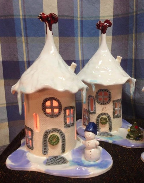 Christmas collection of ceramic tealight candlesticks in the form of wonderful snow-covered houses