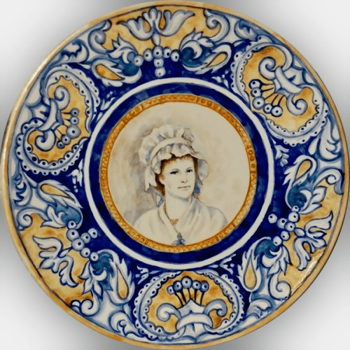 Another Renaissance ceramic plate with a portrait of a lady in a medieval costume and ornamental frame