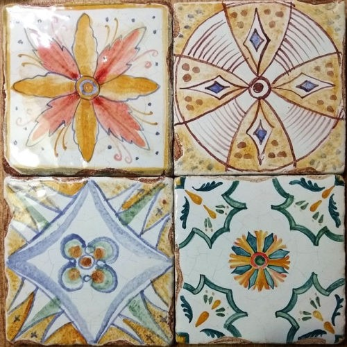 Small hand-molded tiles with European ornaments, slight geometry disturbance, crackle effect and aging