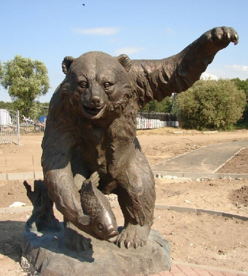 Monuments to Bear in Russia. Monument to a Bear with fish in Millennium Park of Yaroslavl. Luxurious gift from Zurab Tsereteli