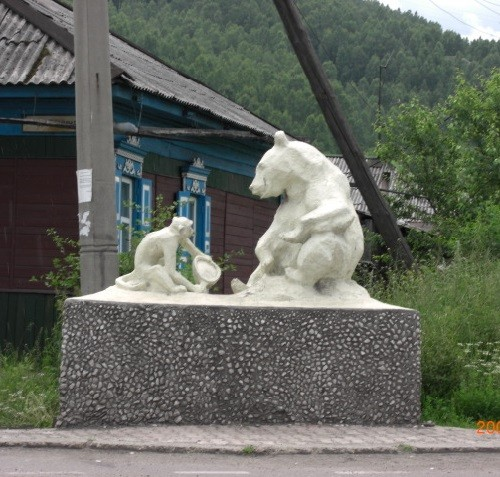 Monuments to Bear in Russia. Sculpture of a bear and a monkey. Considered to be one of the most unusual monuments in Russia. Located in Sludyanka
