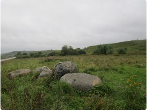 Blue Stone Sin-Kamen. Glacial boulders near the Slavic settlement of Kleshchin with a distant view of Alexandrov Mountain