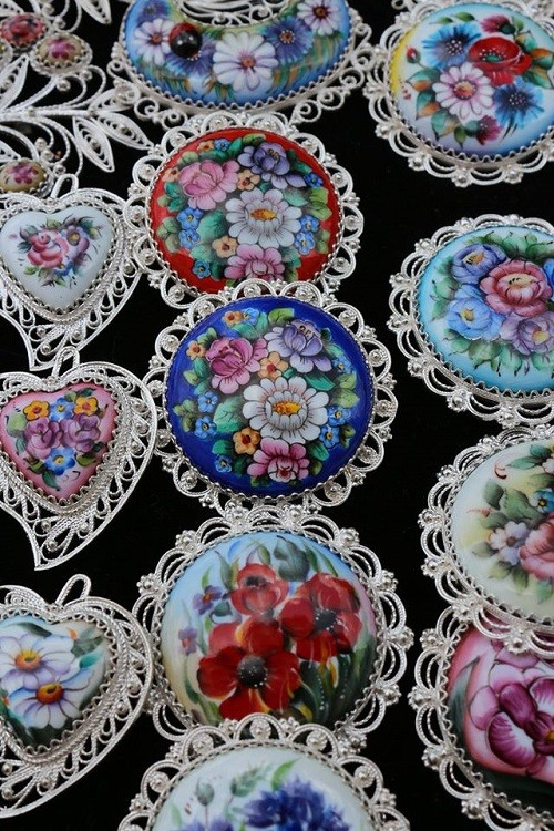 Finift (enamel) brooches and pendants, sold by craftsmen at the walls of the Rostov Kremlin