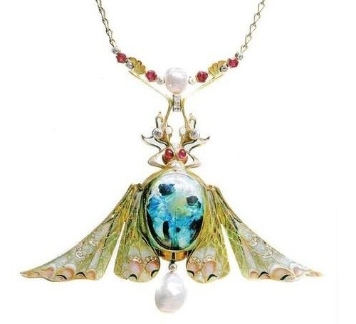 An Art Nouveau Enamel, Diamond and Gold jewellery