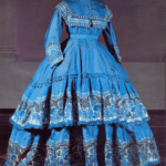 Gown of blue faille with a woven floral pattern, 1860s