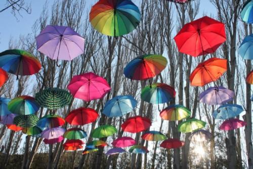 Beautiful installation of umbrellas of different colors. October 21 Multicolored Umbrellas Day