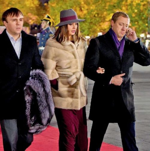 Her husband Andrey (right) does not like publicity
