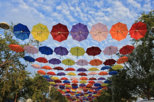 The alley of flying umbrellas of various colors. Art installation in St. petersburg