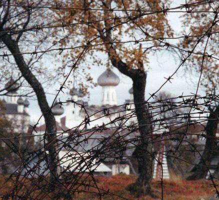 Spaso-Preobrazhensky Solovetsky Stavropol Monastery. Beyond the thorns is the village of Solovki