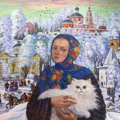 Russian girl in a scarf holding a cat in her arms