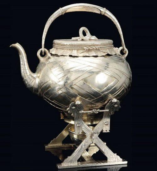 Silver teapot trompe l'oeil on a stand,