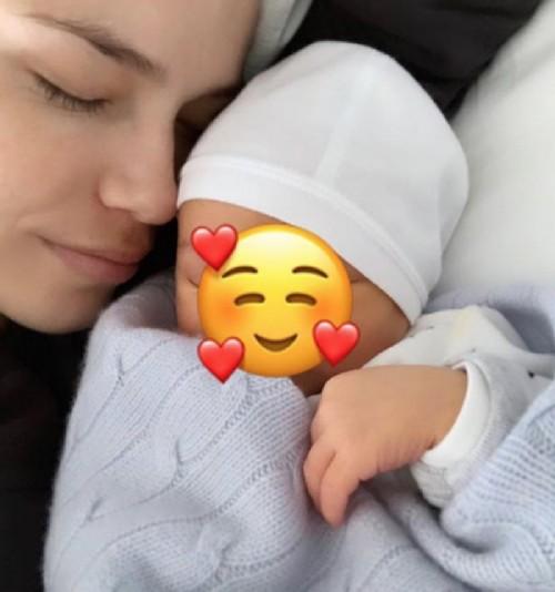 Natasha Poly with her newborn son