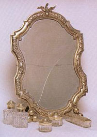 Postnikov. A toiletry set consisting of two bottles, two containers for powder, a comb box and a mirror in a frame.