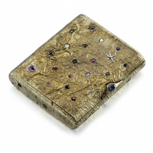 Silver cigar case with gilding and precious stones of various colors and cuts, including garnet, tourmaline, sapphire and ruby. Ovchinnikov, 1899-1903