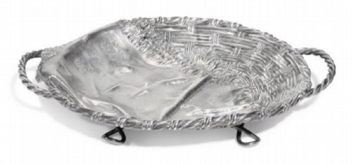 Silver dish in the style of Trompe L'oeil in the form of a wicker basket covered with a napkin. P. Ovchinnikov, Moscow, 1872