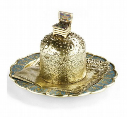 Silver salt shaker with gilding and enamel in the style of Trompe L'oeil in the form of a cake on a napkin over a saucer. P. Ovchinnikov, Moscow, late 19th century.