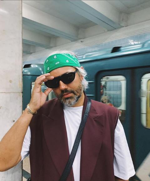 Alexander Rogov in a green suit