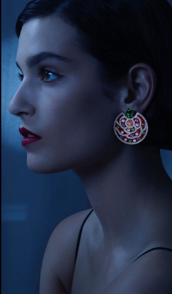 Chanel Russian collection. Folklore earrings are a jewelry interpretation of colorful embroidery on Russian national costumes. The model is lacquered in scarlet, Gabrielle Chanel's favorite color, and decorated with tsavorites, orange garnets, blue and pink sapphires, diamonds and pearls.
